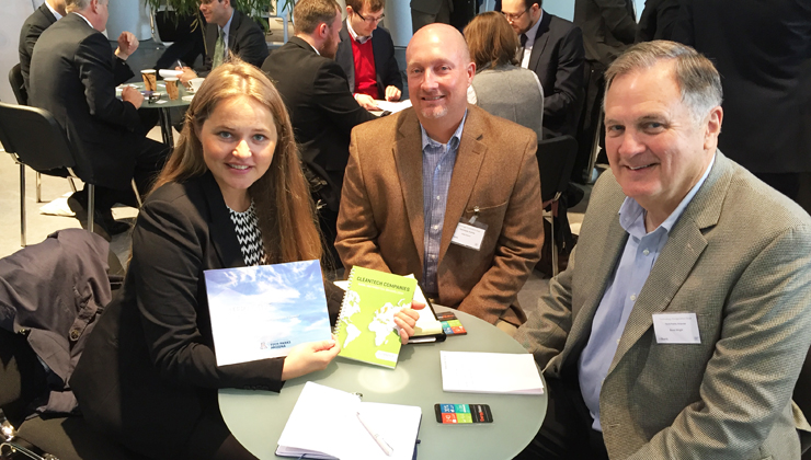 Triinu Varblane from Merinova presents the Cleantech Kvarken  Company Catalogue to Justin Dutram and Bruce A. Wright